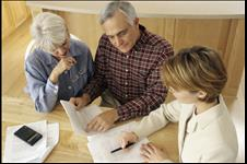 Older couple looking at estate planning documents with an attorney
