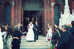 Bride and Groom walking out of church