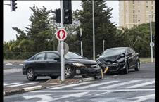 Two cars in an accident at a traffic light