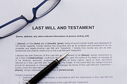Last Will and Testament with a pen and glasses