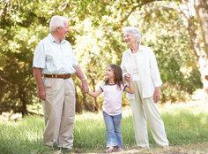Grandparents holding grabddaighter