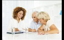 Older couple consulting with an attorney