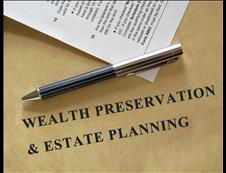 Pen sitting on a wealth preservation & estate planning document