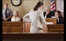 Lawyer asking questions of a witness in a courtooom