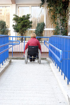 Wheelchair going down a walkway