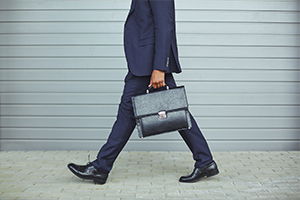 Businessman walking along with a suitcase
