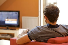 Man sitting on couch walking TV