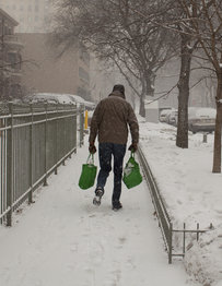 Man carrying groceries in the snow