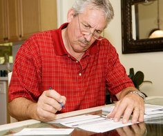 Senior looking at bills