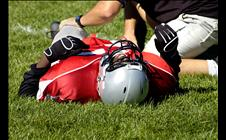 Football player hurt on the ground