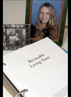 Family pictures framed behind a Revocable Living Trust