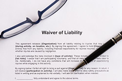 Waiver of Liability with glasses and a pen on it