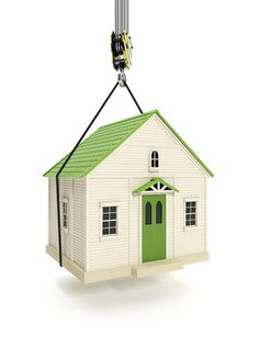 House dangling from a crane