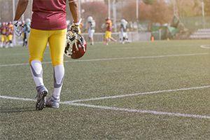 Football player holding his helmet