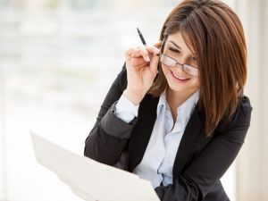 Businesswoman smiling and adjusting glasses