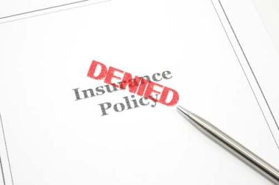 insurance policy document with denied stamped on top