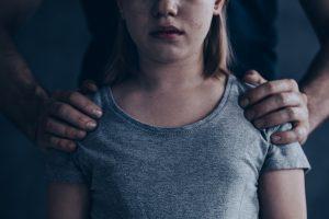 hands on daughters shoulders