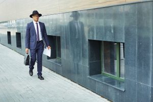 Man in hat and suit walking