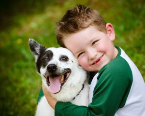 Small boy holding a dog
