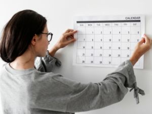 Woman putting up a calendar