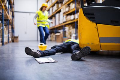 worker injured next to heavy machinery