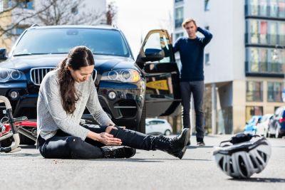 car accident involving female bicyclist
