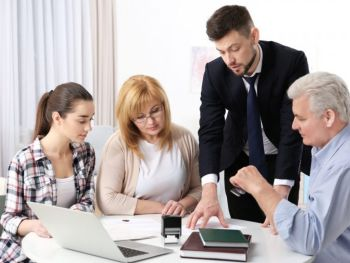 Family of Three being consulted by a lawyer