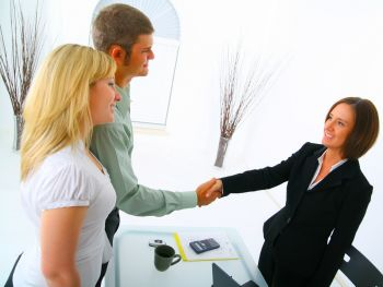 Couple meets with an attorney and shakes her hand