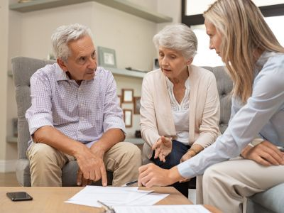 business agent planning with an older couple