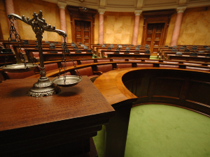 Scales of justice in empty courtroom