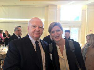 John Foley smiling for photo with Samantha Power