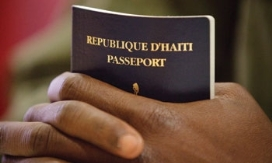 Close up of person's hands holding a passport