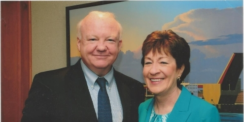 Foley posing with senator Susan Collis for a picture