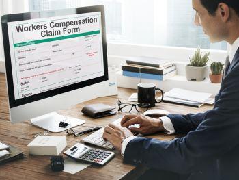 Man filling out a worker's compensation claim form online