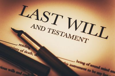 Last Will and Testamend document with pens laid on top