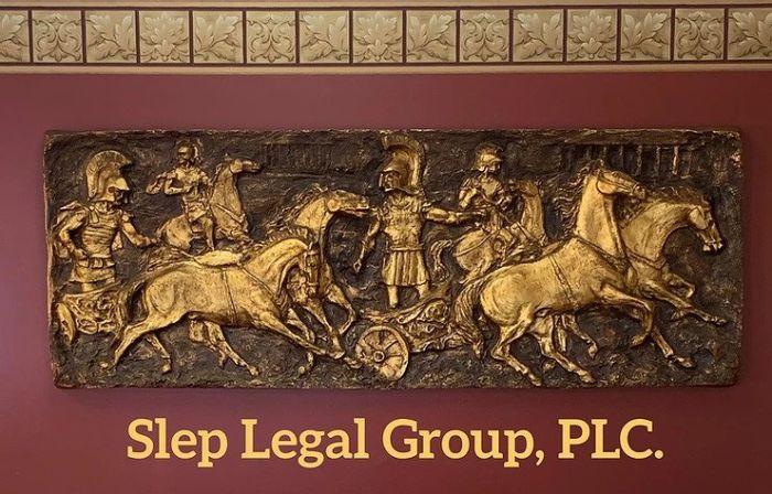 Shep Legal Group, PLC graphic under a roman art carving