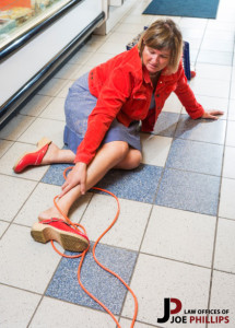 Woman on floor with cord wrapped around her ankle