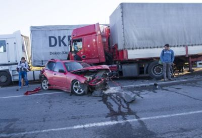 Semi Truck facing damaged car