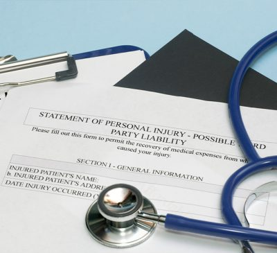 """Stethescope on top of document with the title """"Statement of Personal Injury"""""""