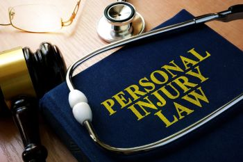 Personal Injury Law book with a stethoscope on top