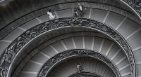 People walking down a spiral staircase