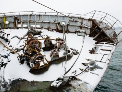 Boat covered in snow tilting over