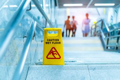 Caution wet floor sign at the top of stairs